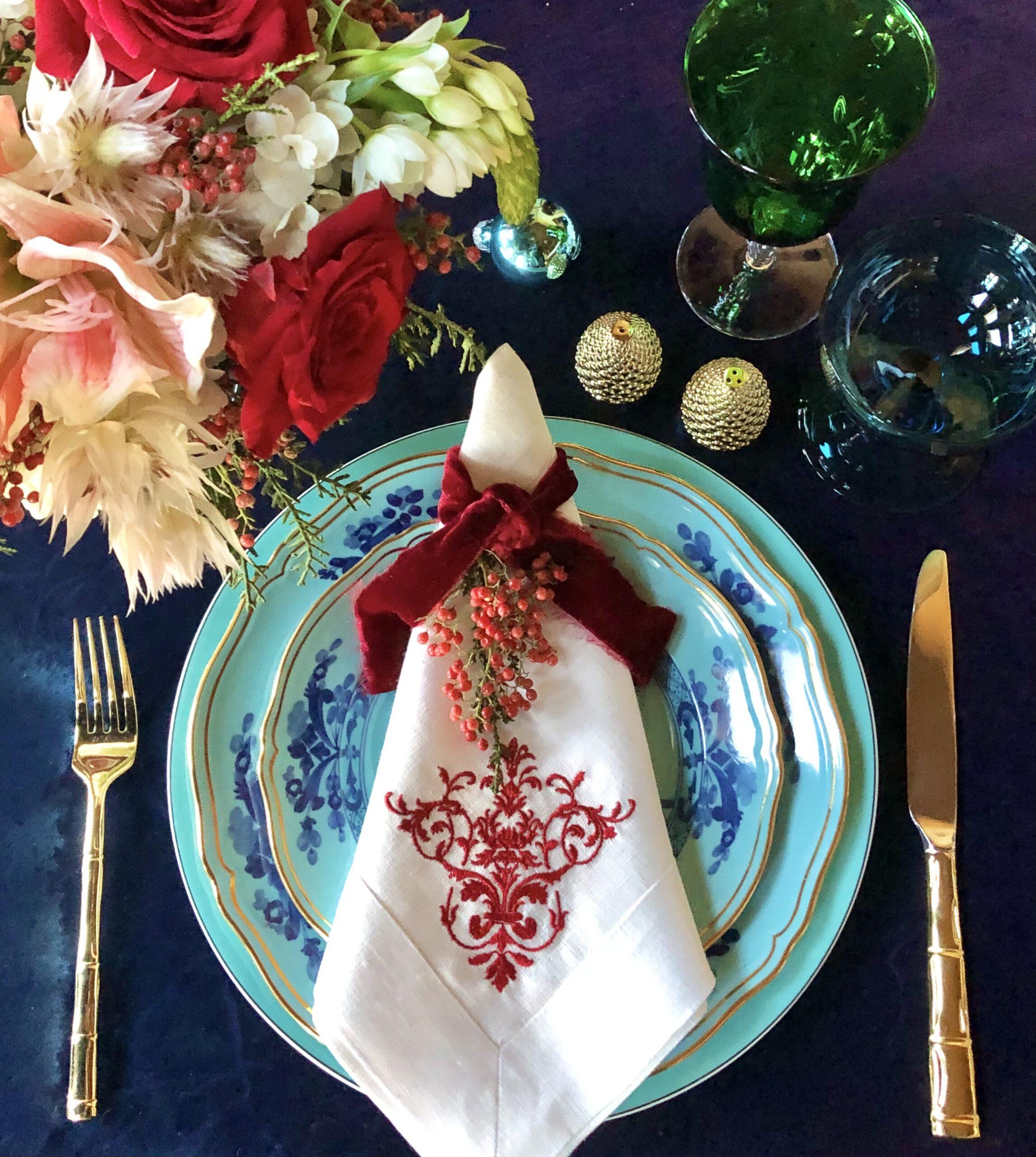 Christmas place setting with Azure Richard Ginori plates and Crown Linen Napk
